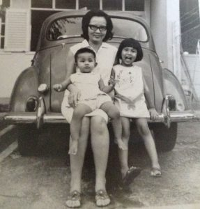 That's Delia on the right, with her little sister and Mum. The old Morris Minor was the family's first car.