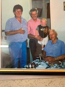 4 generations picture. John is the one in pink. Seated is John's Dad, Peter McMahon. He was a railway signal man, and played Trugo for Yarraville. Man next to John is his son Peter. John is holding on to Peter's son, Jarrod. Jarrod also plays Trugo for Yarraville.
